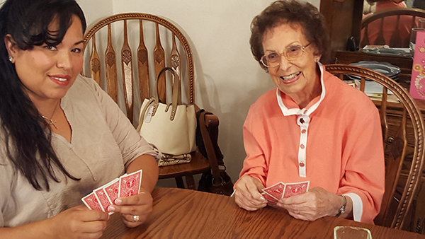 Caregiver and Zel playing cards